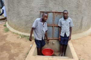 The Water Project:  Derrick And A Friend Getting Water