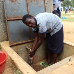 The Water Project: Matungu SDA Special School -  Grace Washing Her Hands At The Rain Tank
