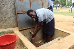 The Water Project:  Grace Washing Her Hands At The Rain Tank