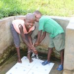 The Water Project: Musango Community, Ndalusia Spring -  Washing Hands With Clean Water