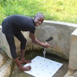 The Water Project: Musango Community, Ndalusia Spring -  Enjoying The Clean Water
