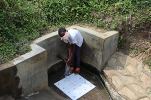The Water Project:  Enjoying Spring Water