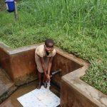 The Water Project: Sichinji Community, Makhatse Spring -  Triza Enjoying Clean Water