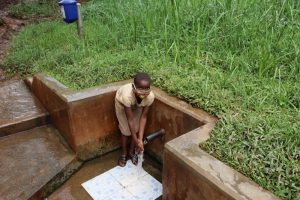 The Water Project:  Triza Enjoying Clean Water