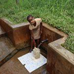 The Water Project: Sichinji Community, Makhatse Spring -  Triza Fetching Water
