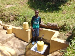 The Water Project:  Leon Fetching Water