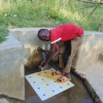 The Water Project: Mukoko Community, Mshimuli Spring -  Ramsey Enjoying The Spring Water