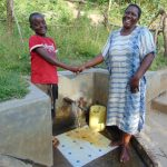 The Water Project: Mukoko Community, Mshimuli Spring -  Handshake At The Spring