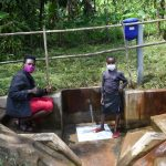 The Water Project: Bukhakunga Community, Mukomari Spring -  Field Officer Shigali With Adasia At The Spring