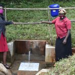 The Water Project: Bukhakunga Community, Mukomari Spring -  Ms Shigali With Ms Pamela At The Water Point