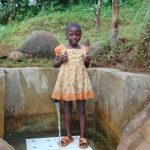 The Water Project: Musango Community, Mwichinga Spring -  Mitchel Gives Thumbs Up At The Spring