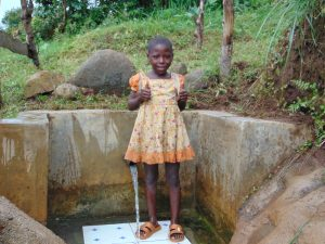 The Water Project:  Mitchel Gives Thumbs Up At The Spring