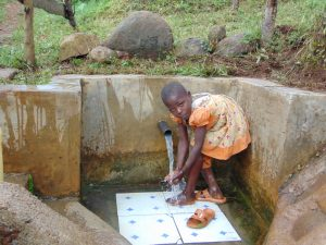 The Water Project:  Mitchel Rinsing Off At The Spring