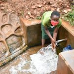 The Water Project: Mutao Community, Shimenga Spring -  Loreen Handwashing At The Spring
