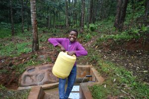 The Water Project:  Carrying Water From Mwore Spring