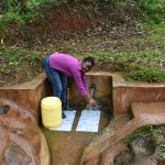 The Water Project: Mukhunya Community, Mwore Spring -  Fetching Water At Mwore Spring