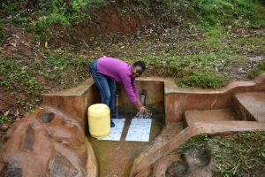 The Water Project:  Fetching Water At Mwore Spring