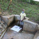 The Water Project: Emukangu Community, Okhaso Spring -  Godfrey At The Spring