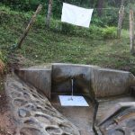 The Water Project: Emukangu Community, Okhaso Spring -  Water Flowing