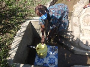 The Water Project:  Madam Rebecca Fetching Water