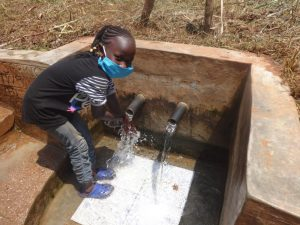 The Water Project:  Vironitana Enjoying The Clean Water