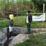 The Water Project: Bukhaywa Community, Shidero Spring -  Gloria Carrying Water