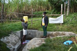 The Water Project:  Gloria Carrying Water
