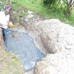 The Water Project: Shianda Township Community, Olingo Spring -  Laying The Foundation