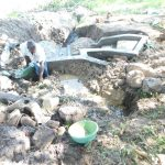 The Water Project: Shianda Township Community, Olingo Spring -  Reinforcing The Headwall With Clay