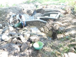 The Water Project:  Reinforcing The Headwall With Clay