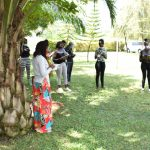 The Water Project: Shianda Township Community, Olingo Spring -  Team Leader Emmah Talks To Kisasi University Students