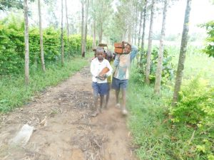 The Water Project:  Teamwork To Bring Materials To Site