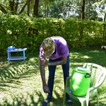The Water Project: Shianda Township Community, Olingo Spring -  Trainer David Washes Up To His Elbows