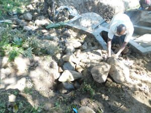 The Water Project:  Backfilling With Large Rocks