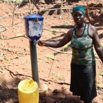 The Water Project: Shihome Community, Peter Majoni Spring -  Using The Chlorine Dispenser At The Spring