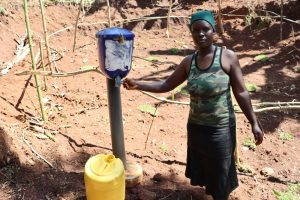 The Water Project:  Using The Chlorine Dispenser At The Spring