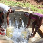The Water Project: Shihome Community, Peter Majoni Spring -  Fetching Water