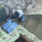 The Water Project: Machemo Community, Boaz Mukulo Spring -  Tile Setting