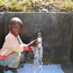 The Water Project: Machemo Community, Boaz Mukulo Spring -  Child Playing With Water