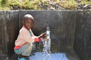 The Water Project:  Child Playing With Water
