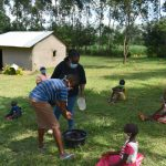 The Water Project: Machemo Community, Boaz Mukulo Spring -  Demonstrating Handwashing With Assistance