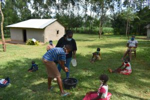 The Water Project:  Demonstrating Handwashing With Assistance