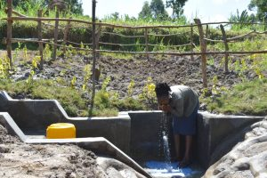 The Water Project:  Woman Drinking Water