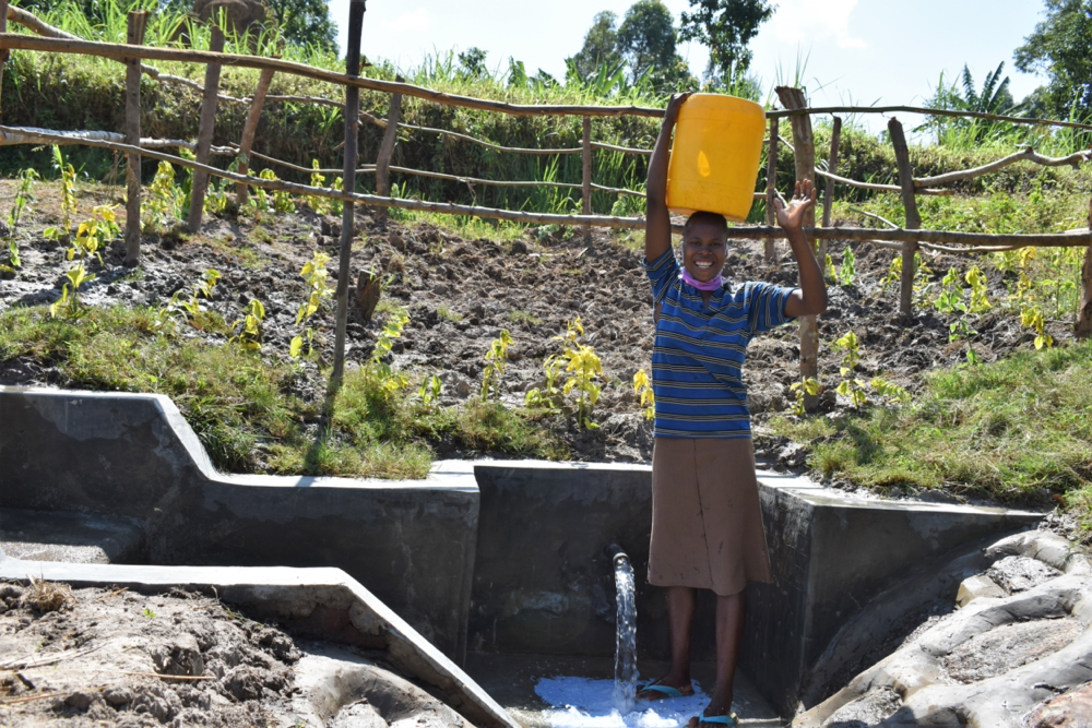 The Water Project : kenya20173-woman-ready-to-bring-clean-water-home-2