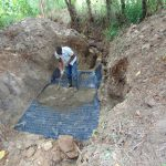 The Water Project: Kimang'eti Community, Kimang'eti Spring -  Casting Of The Foundation With Concrete