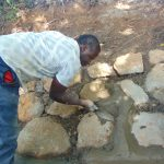 The Water Project: Kimang'eti Community, Kimang'eti Spring -  Stone Pitching Plaster