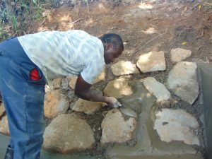 The Water Project:  Stone Pitching Plaster