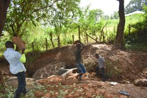 The Water Project:  Delivering Large Stones For Backfilling