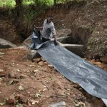 The Water Project: Kimang'eti Community, Kimang'eti Spring -  Fitting The Tarp