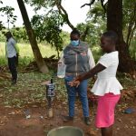 The Water Project: Kimang'eti Community, Kimang'eti Spring -  Community Member Tries Out The Ten Handwashing Steps